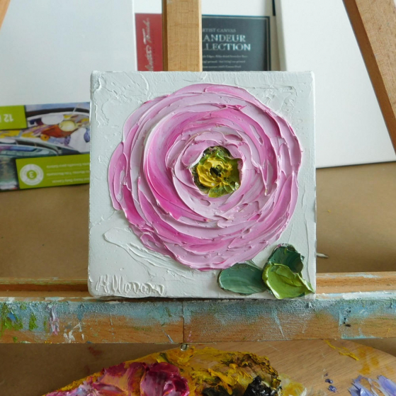pink ranunculus  painting on a easel