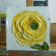 yellow ranunculus oil painting on a easel